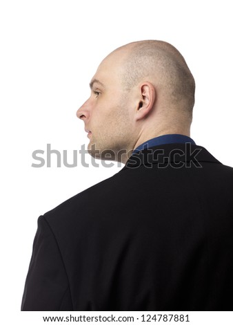 Rear view of a handsome mid adult businessman looking away while standing against white background