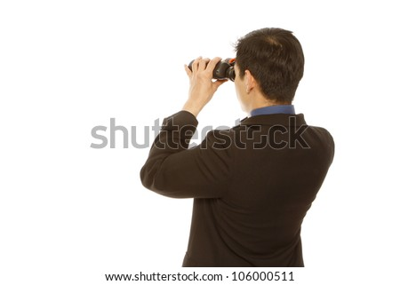 Rear view of a man in business attire using binoculars (on white) - stock photo