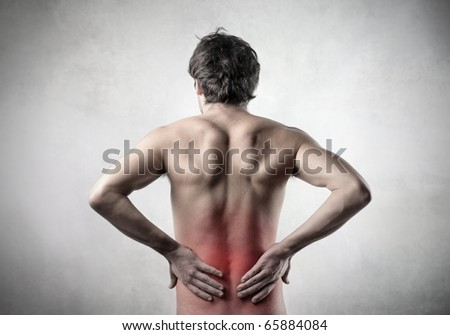 Rear view of a man with backache - stock photo