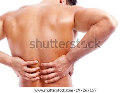Rear view of a muscular man holding his back in pain, isolated on white background - stock photo
