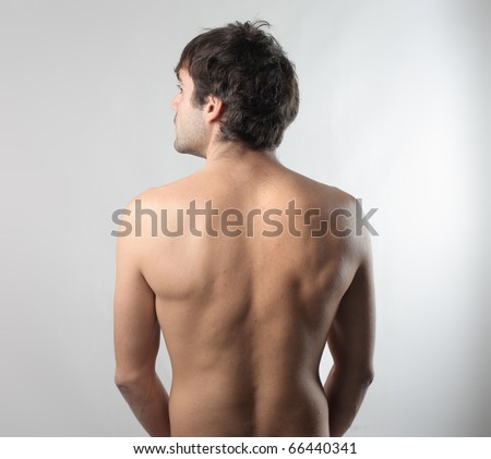 Rear view of a naked man - stock photo