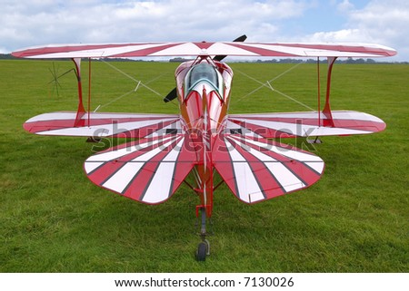 Rear view of a red biplane, now used for aerobatics. - stock photo