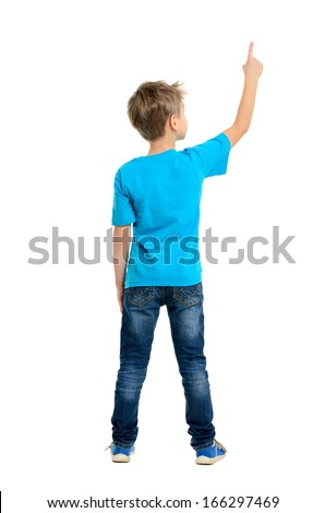 Rear view of a school boy over white background pointing upwards. Full length portrait - stock photo