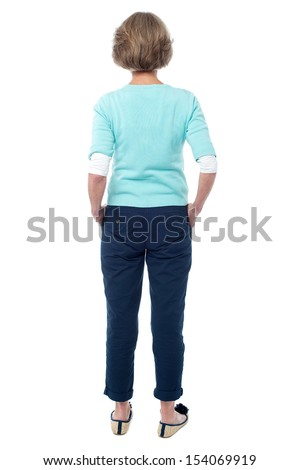 Rear view of a senior citizen in trendy wear - stock photo