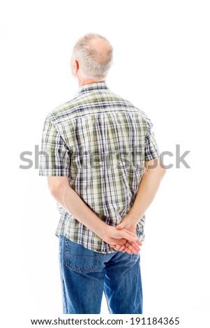 Rear view of a senior man thinking - stock photo