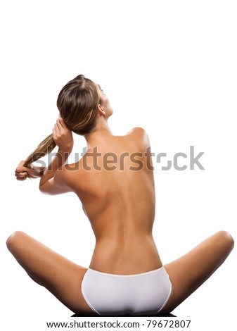Rear view of a sexy topless woman holding her long blond hair isolated on white background - stock photo