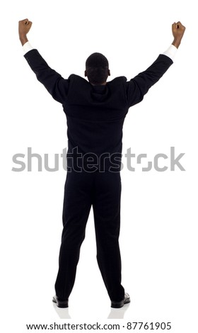 Rear view of a successful black business man with his arms up isolated white - stock photo