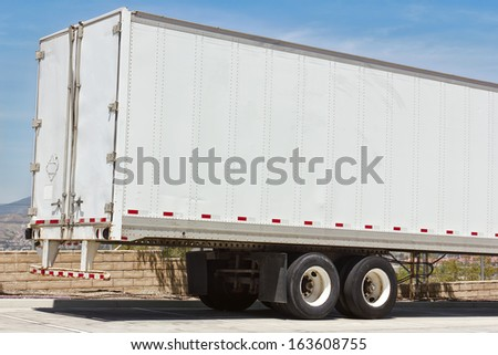 Rear view of a truck trailer - stock photo