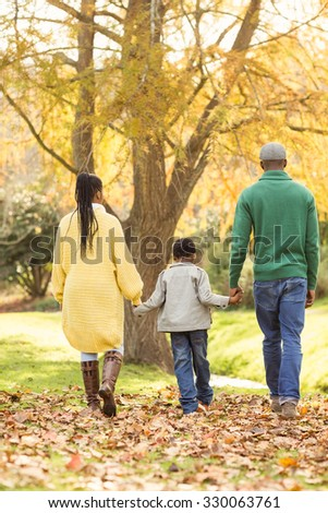 Rear view of a young family on an autumns day