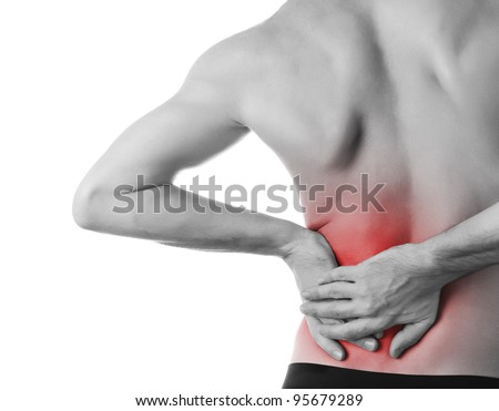 Rear view of a young man holding his back in pain, isolated on white background, monochrome photo with red as a symbol for the hardening - stock photo