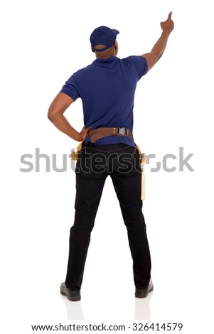 rear view of african handyman pointing at empty space isolated on white background - stock photo