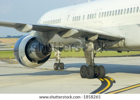 Rear view of airliner on a taxiway - stock photo