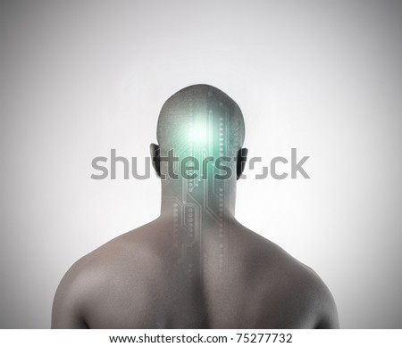 Rear view of an african man with microchip on his head - stock photo