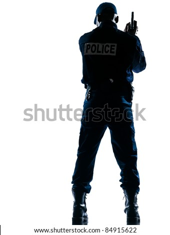 Rear view of an afro American police officer holding handgun on white isolated background - stock photo