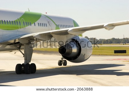 Rear view of an airliner as it taxiis across an airport - stock photo