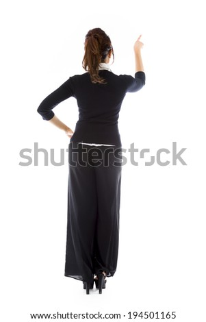 Rear view of an Indian young woman pretending to working on virtual screen - stock photo