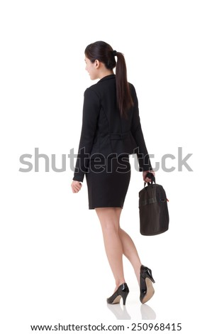 Rear view of Asian business woman, full length portrait with reflection on studio white background. - stock photo