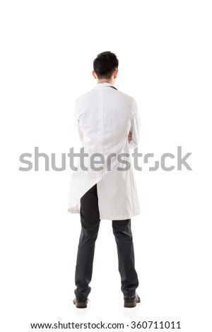 Rear view of Asian medical doctor, full length portrait isolated - stock photo