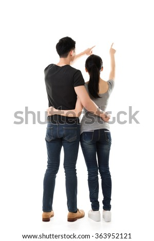 rear view of Asian young couple, full length isolated - stock photo