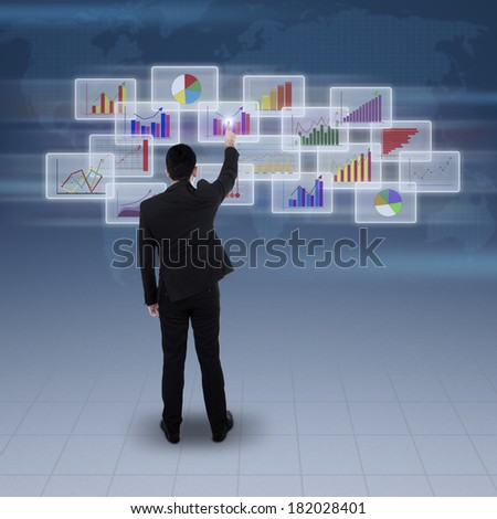 Rear view of businessman clicking on futuristic screen over blue digital world map
