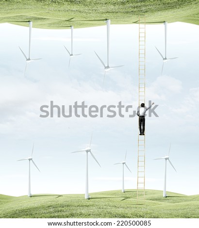Rear view of businessman climbing ladder between two realities - stock photo