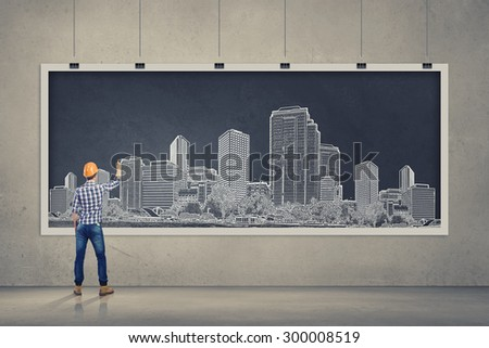 Rear view of businessman drawing business plan on banner - stock photo