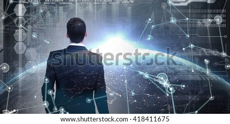 Rear view of businessman holding a briefcase against image of a earth - stock photo
