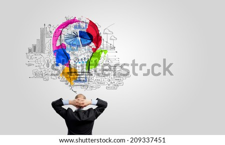 Rear view of businessman looking at business ideas - stock photo