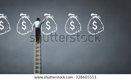 Rear view of businessman standing on ladder and reaching money sign  - stock photo