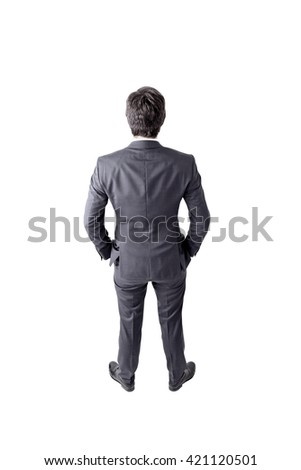 Rear view of businessman with hands in pockets isolated on white background - stock photo