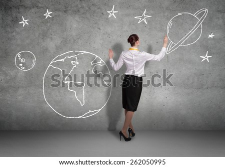 Rear view of businesswoman presenting drawn Earth planet