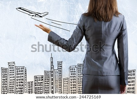 Rear view of businesswoman with travel sketch at background - stock photo