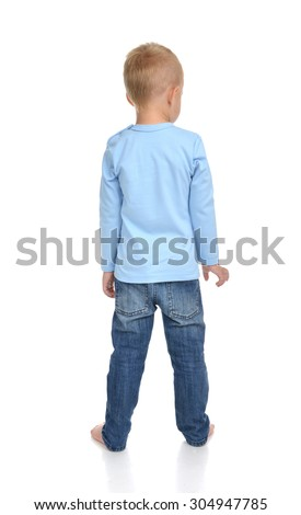 Rear view of caucasian full body american baby boy kid in blue sweater and jeans standing isolated on a white background - stock photo