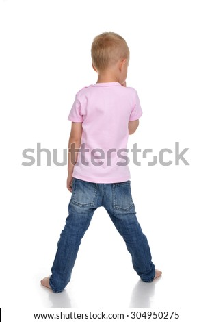 Rear view of caucasian full body american baby boy kid in pink tshirt and jeans isolated on a white background - stock photo