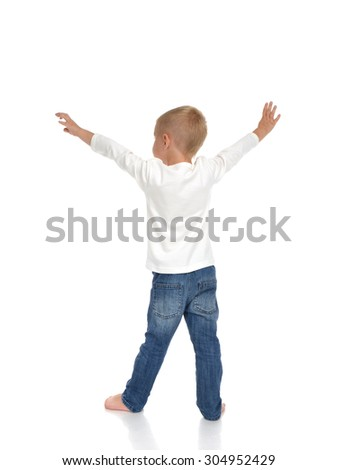 Rear view of caucasian full body american baby boy kid with arms open feeling freedom and happiness standing isolated on a white background - stock photo