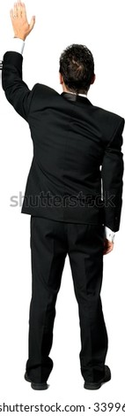 Rear view of Caucasian man with short black hair in a tuxedo waving - Isolated - stock photo