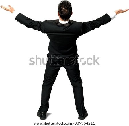 Rear view of Caucasian man with short black hair in a tuxedo with arms open - Isolated - stock photo