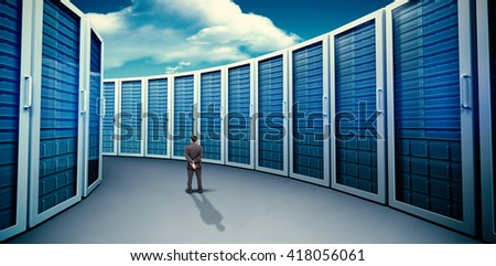 Rear view of classy businessman posing against composite image of server towers