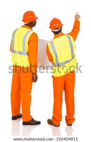 rear view of construction co-worker pointing on white background - stock photo