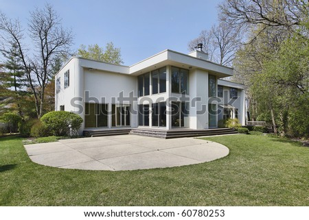 Rear view of contemporary home with patio - stock photo