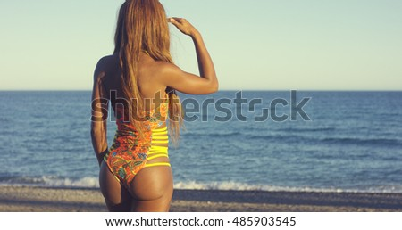 Rear View of Curved Body  a Woman in Swimsuit
