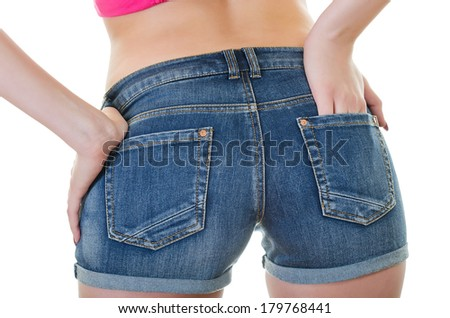 Rear View of Denim Shorts on a Young Woman with her Hand in Right Pocket, over white - stock photo