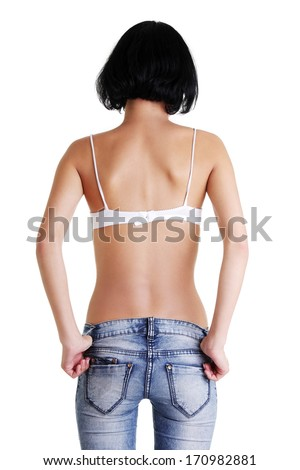 Rear view of fit female in blue jeans, isolated on white  - stock photo
