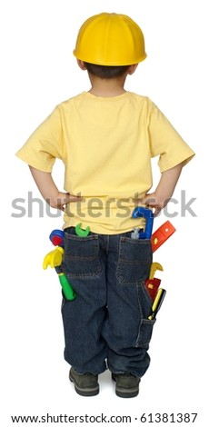 Rear view of four-year-old boy dressed as a construction worker with tools in pants pockets, isolated on pure white background - stock photo