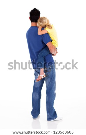 rear view of loving father carrying little daughter - stock photo