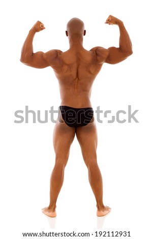rear view of male african bodybuilder standing on white background - stock photo