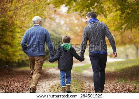 Rear View Of Male Multl Generation Family Walking On Path - stock photo
