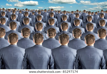 Rear view of many identical businessmen clones - stock photo