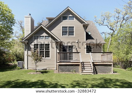 Rear view of new construction home with deck - stock photo