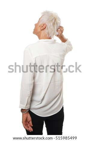 Rear view of older woman scratching her head, isolated on white.